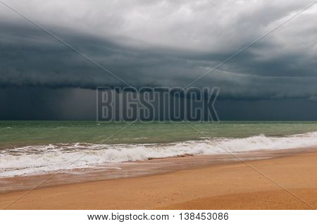 The landscape with the dark stormy sky and the sea.