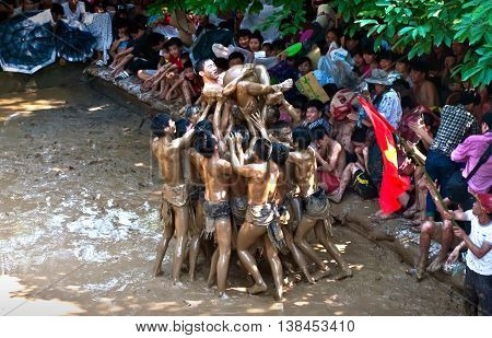 BAC GIANG, VIET NAM, June 21, 2016 group of men, sports and entertainment, ball of mud, mud bridge, called objects. Unique festival, Van village, Bac Giang province, Vietnam