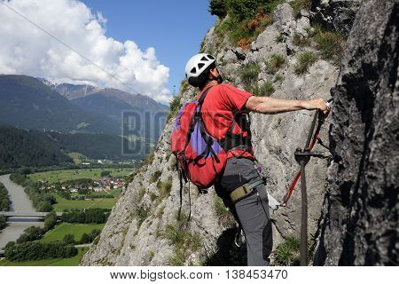 climbing man is going on a rope way
