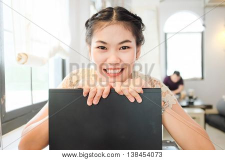 Freelance E Business Asian Women Using Laptop Computer In Coffee Shop