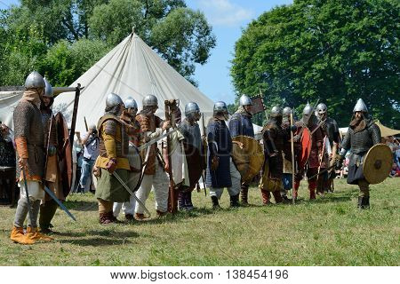 KERNAVE, LITHUANIA - JULY 7: Unidentified people in a Medieval fights at 14th International Festival of Experimental Archaeology on July 7, 2013. Its a most popular folklore event on July in Lithuania