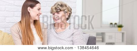 Granddaughter And Grandmother Laughing Together