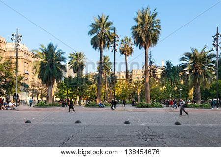 Santiago Region Metropolitana Chile - June 06 2016: A view of buildings an people at Plaza de Armas the main square of Santiago de Chile and a gathering point for tourists immigrants and Chilean citizens.