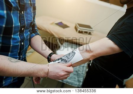 Tattoo Master Puts Sketch At Hand Of Client