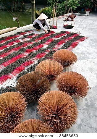HA NOI, VIET NAM, March 22, 2016 the woman, countryside Ha Noi, Vietnam, incense dried