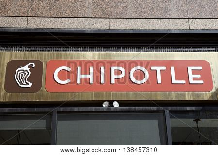 New York, United States of America - August 16, 2016: Entrance to Chipotle Mexican grill in New York,  A fast food restaurant chain with 2000 restaurants around the world