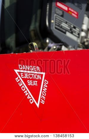 Detail Of Danger Ejection Seat Warning Sign On Jet Airplane