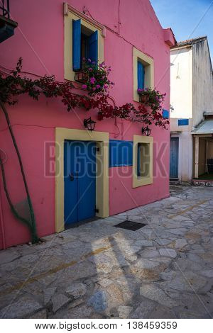 City Landscape With Pink House In Fiscardo, Kefalonia, Greece
