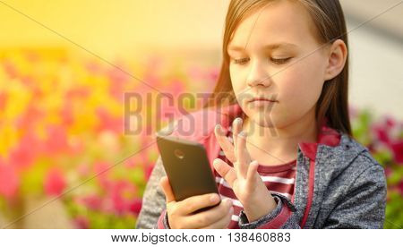 Girl is reading something on a phone