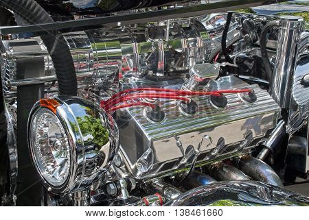Partial view of a 1933 Roadster chromed engine compartment