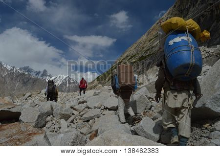 Porters on the Baltoro Glacier, in Gilgit-Baltistan, Pakistan.