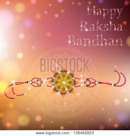 Beautiful creative rakhi on shiny background for Indian festival of brother and sister love Happy Raksha Bandhan celebration.