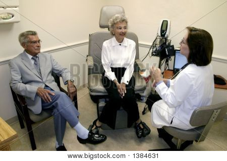 Picture or Photo of Female geriatrician discussing senior health issues with her two elderly patients