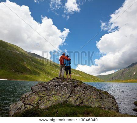 Couple on mountains lake