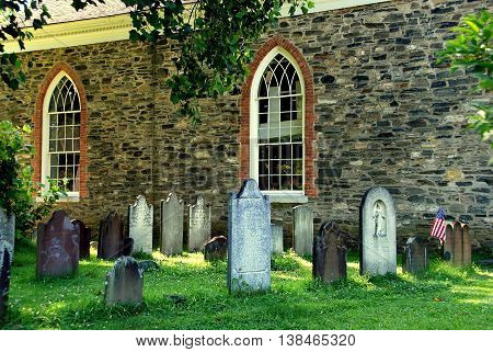 Sleepy Hollow NY - July 9 2009: Burial ground stones and 1685 Old Dutch Church of Sleepy Hollow