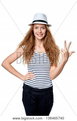 Hand counting - three fingers. Happy summer woman in straw fedora hat showing three fingers