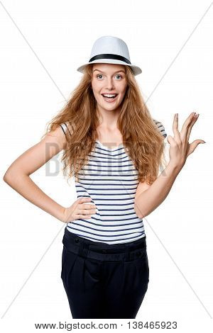 Hand counting - four fingers. Happy summer woman in straw fedora hat showing four fingers