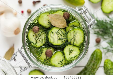 Pickled Cucumbers Closeup In A Jar. Top View. Homemade Vegetable Canning.