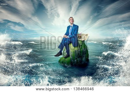 Calm, smiling man sitting on a rock. Around the raging storm.