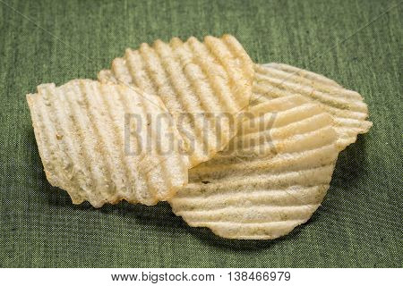 Tasty Golden rippled potato chips close up