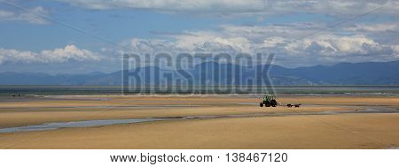 Sandy beach and mountain range. Scene in Marahau New Zealand.