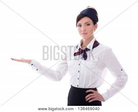 Portrait Of Welcoming Stewardess In Uniform Isolated On White
