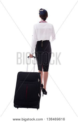 Back View Of Young Stewardess Walking With Suitcase Isolated On White