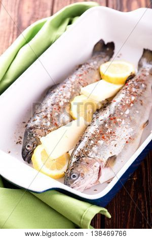 Two Fresh Trouts With Lemon And Butter In Pan
