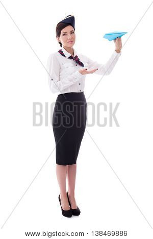 Full Length Portrait Of Young Stewardess With Paper Plane Isolated On White