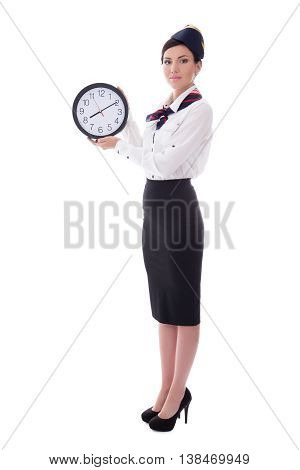 Portrait Of Young Stewardess With Office Clock Isolated On White