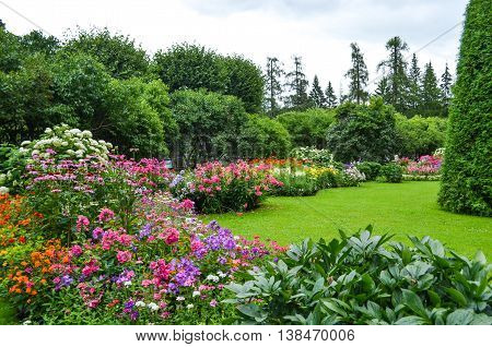 Summer garden in Saint Petersburg city, landscape. Beautiful park, flowers and trees view, green lawn, grass. Famous historical place.