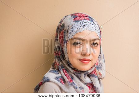 Close up of beautiful asian muslim woman looking.