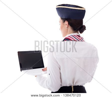 Back View Of Young Stewardess Showing Laptop With Blank Screen Isolated On White