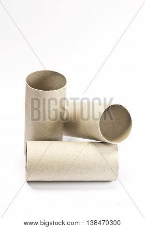 Empty toilet paper rolls on white background
