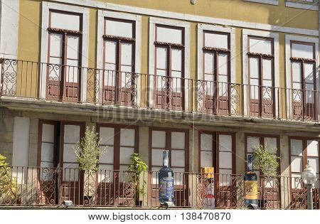 PORTO, PORTUGAL - AUGUST 10, 2016: Publicity of Wine on balcony of a building located in the street of Flowers in Porto Portugal.