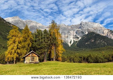 Autumn scenery of Miemenger Plateau with rocky mountains peaks in the background. Austria Europe Tyrol.