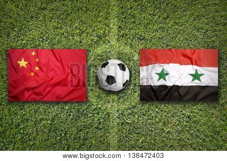 China Vs. Syria Flags On Soccer Field
