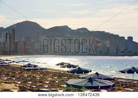 Benidorm sunrise with hammocks and parasol umbrellas with skyline background