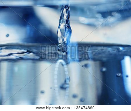 picture of a pouring water into a glass