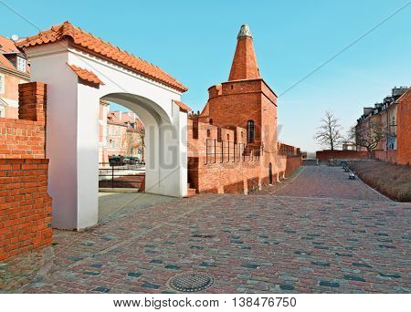 Old town wall and arc near Barbican, Warsaw city, Poland