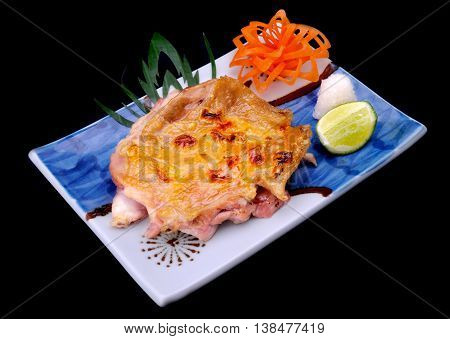 Japanese grilled chicken with salt serve with lemon