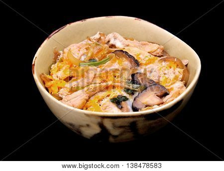 Oyakodon is Japanese style chicken and egg with vegetable on rice in bowl.