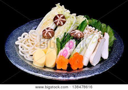 Japanese shabu vegetables set mix with tofu and noodles photo in studio lighting.