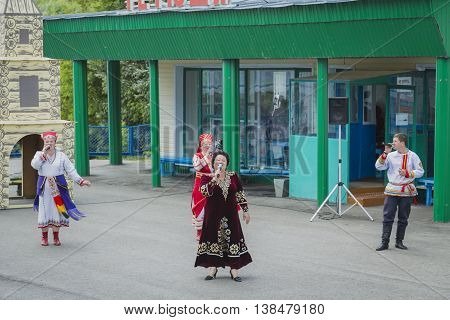 Tetyushi Tatarstan Russia - June 23 2016. Folk group meet with Russian songs the passengers from passenger ship