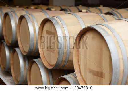 Wooden old barrels of wine at winery