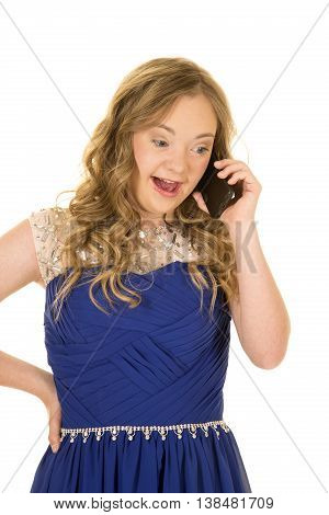 a woman with down syndrome in her fancy blue dress talking and laughing on her phone.
