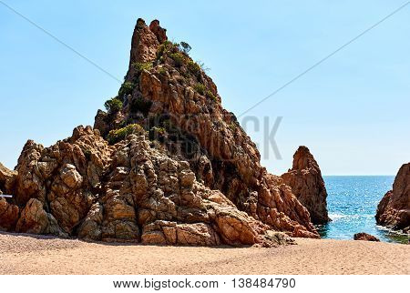 Rocky seaside of Mar Menuda Beach in Tossa de Mar. Costa Brava Spain