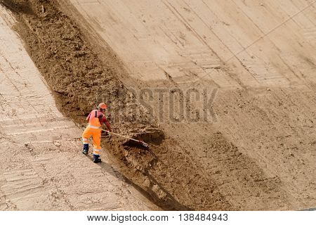 Digger works at new highway construction site