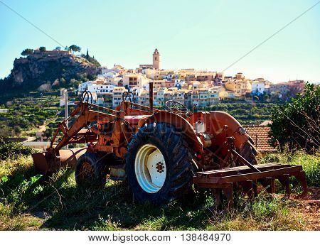 Old tractor and Polop de la Marina village. Province of Alicante Costa Blanca. Spain