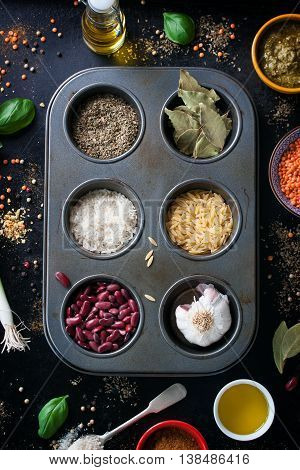 Different types of spices and grains on a vintage background healthy concept top view
